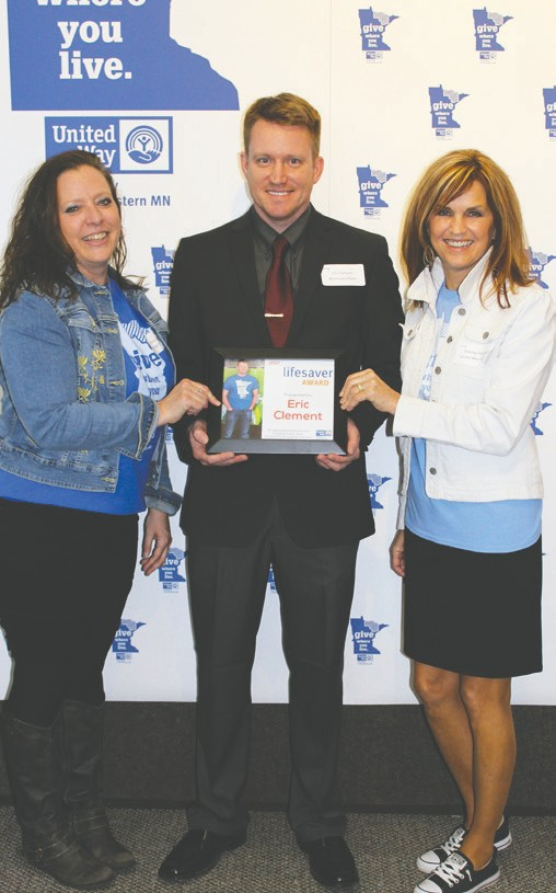 Eric Clement, Lifesaver Award winner, is pictured with Stacy Hart, UWNEMN outgoing president (left) and Shelley Valentini, UWNEMN executive director.