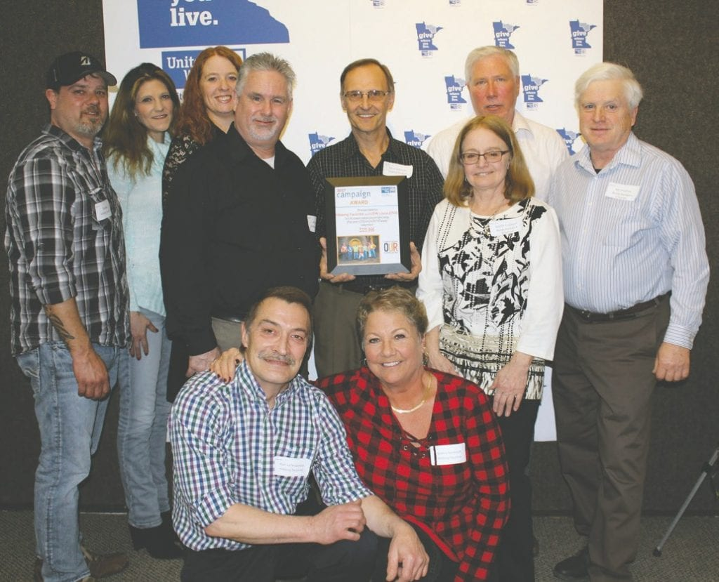 Hibbing Taconite and USW Local 2705 were winners of a UWNEMN Campaign Award and Leadership Giving Award. Pictured accepting the award: Standing (l. to r.) are Tim Davey, Bobbi Jo, Julie Lucas, Jeff Walters, Ed LaTendresse, Frank LaMusga, Debbie Erspamer and Ray Erspamer. Kneeling are Alan LaTendresse (left) and Debbie Randolph.