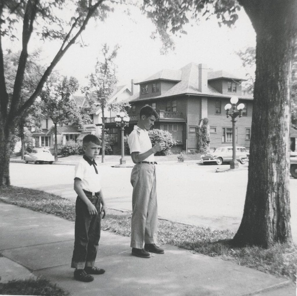 Tom Lanin is shown with his older brother Mike standing in front of their apartment building on 5th Avenue in Virginia in July 1954. Note the lampposts with their five globes. Submitted photo.