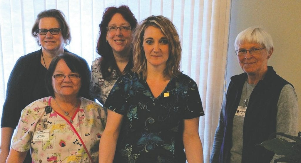 Pictured (back row): Cheri High, St. Michael's administrator/CEO, and nominee Sherry Maki, LPN. Front row: nominee Ramona Suomi, CAN; Sister Claudia Riehl Award winner Misty Jensen, CAN; and nominee Audrey Peterson, physical therapist assistant. Submitted photo.