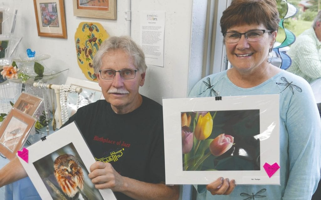 Lauren Nelson (left) won the People's Choice Award in the NWFA Take Your Best Shot photo contest with his Bird on a Stick photo of a northern saw-whet owl. Carol Bowman was the winner of the Adult Award with her Tulips photo. Submitted photos.