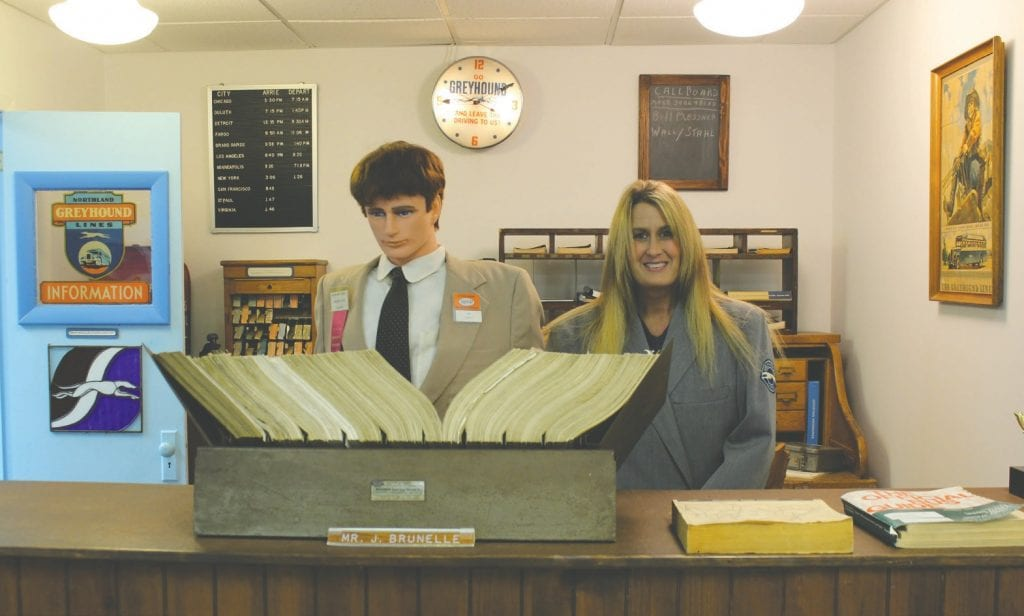 Dana Sanders, as a Greyhound ticket agent at the bus museum in Hibbing.