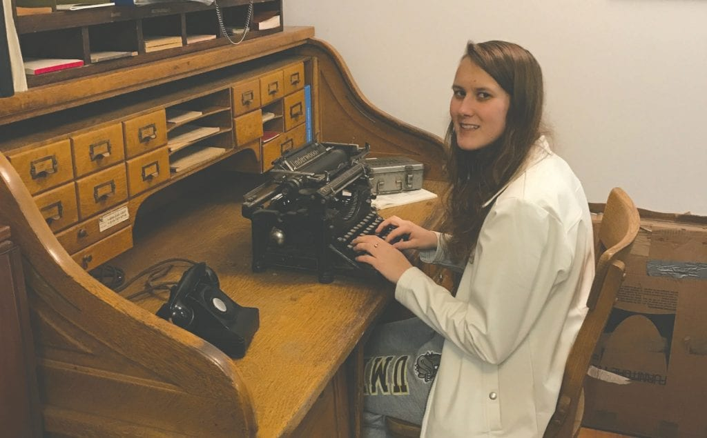 Mia Lawson is ready for office work with an Underwood typewriter.