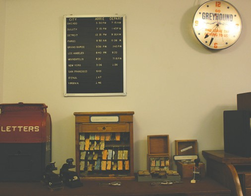 An office display of bus tickets and schedules at the bus museum.