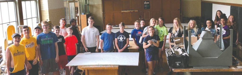 Hibbing High School basketball players get together to paint the backboards of the hoops for the big Hoops on Howard tournament! Submitted photo.