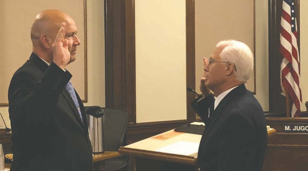 St. Louis County's new director of the Veterans Service Office is officially on board. Tedd Ells (left) took the necessary oath of service Monday, July 30, his first day working for the county. Auditor Don Dicklich administered the oath. Submitted photo.