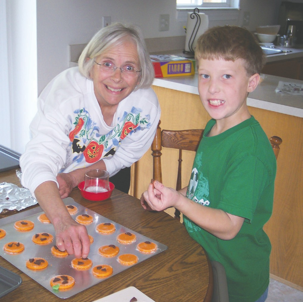 Betty Pond and her grandson Drew Dukart are pictured making cookies for Halloween. Submitted photo.