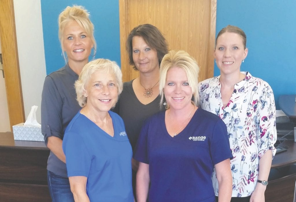 Staff at the newly relocated and remodeled Range Foot & Ankle in Virginia include (l. to r.) front: Connie Baland and Kelly Farkas. Back: Rhonda Hayden, Jaime Banks and Dr. Katie Evans. Submitted photo.