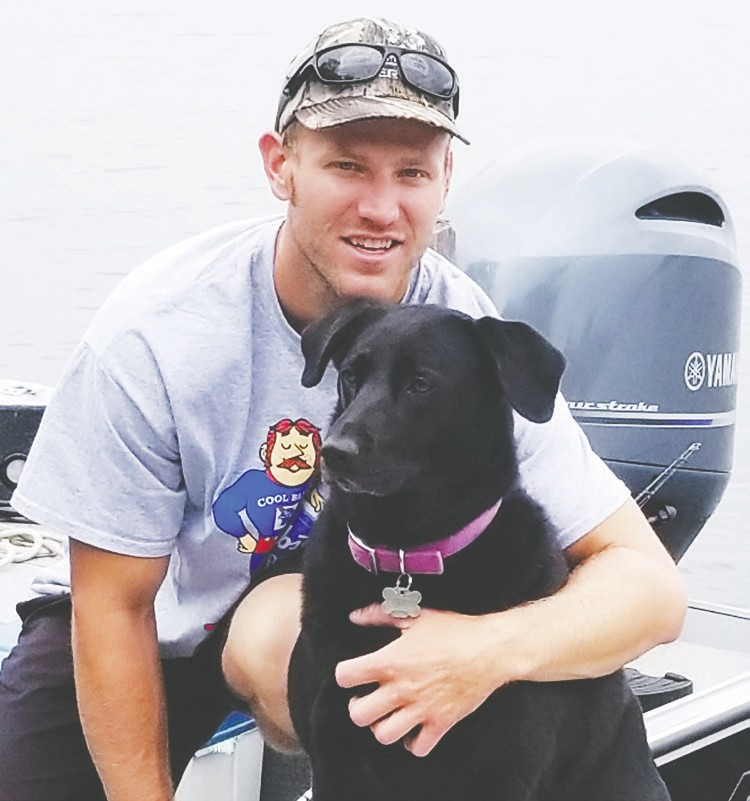 """My fishing guide Andrew """"AJ"""" Judnick and his lucky fishing dog Avery."""