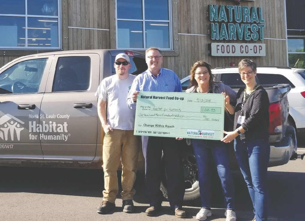 Pictured (l. to r.) are Jason Patterson and Nathan Thompson from North St. Louis County Habitat for Humanity; and Lori Maki and Anja Parenteau from Natural Harvest Food Co-op in Virginia. Submitted photo.