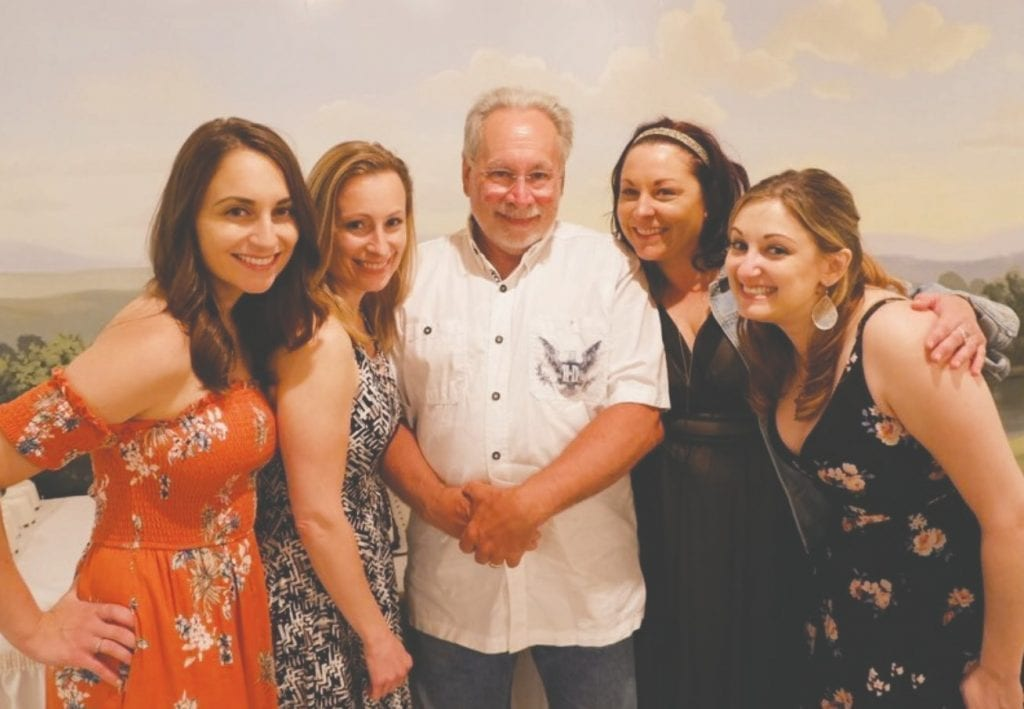 Judge David E. Ackerson is pictured with his daughters in July of 2018, the week he retired from the bench. From left: Chloe, Kristin, Ashlie and Aimee. Submitted photo.