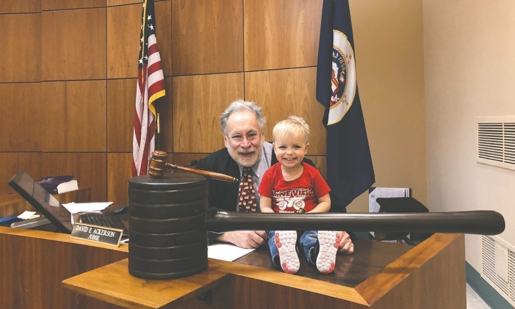 Judge David Ackerson on the bench with Carly Melin's son Teddy Norenberg, age 2, earlier this year. Submitted photo.