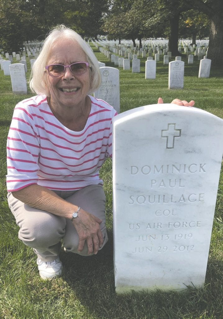 Betty Pond is pictured at the Arlington National Cemetery gravesite of her uncle and aunt, Dominic and Kathleen Squillace.