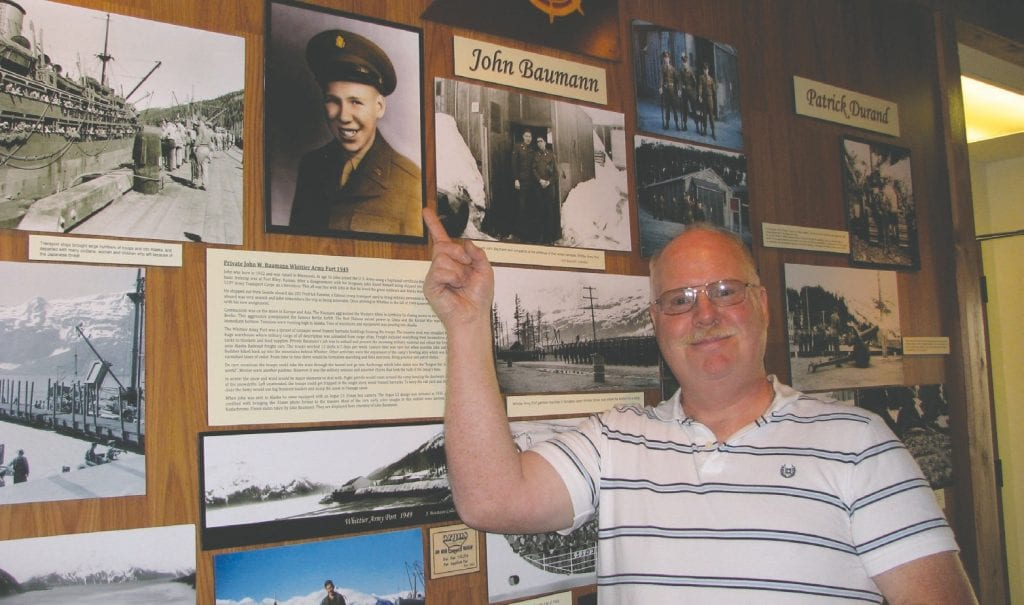Patrick Baumann stands in front of his dad's wall at the museum in Whittier, AK. Submitted photos.