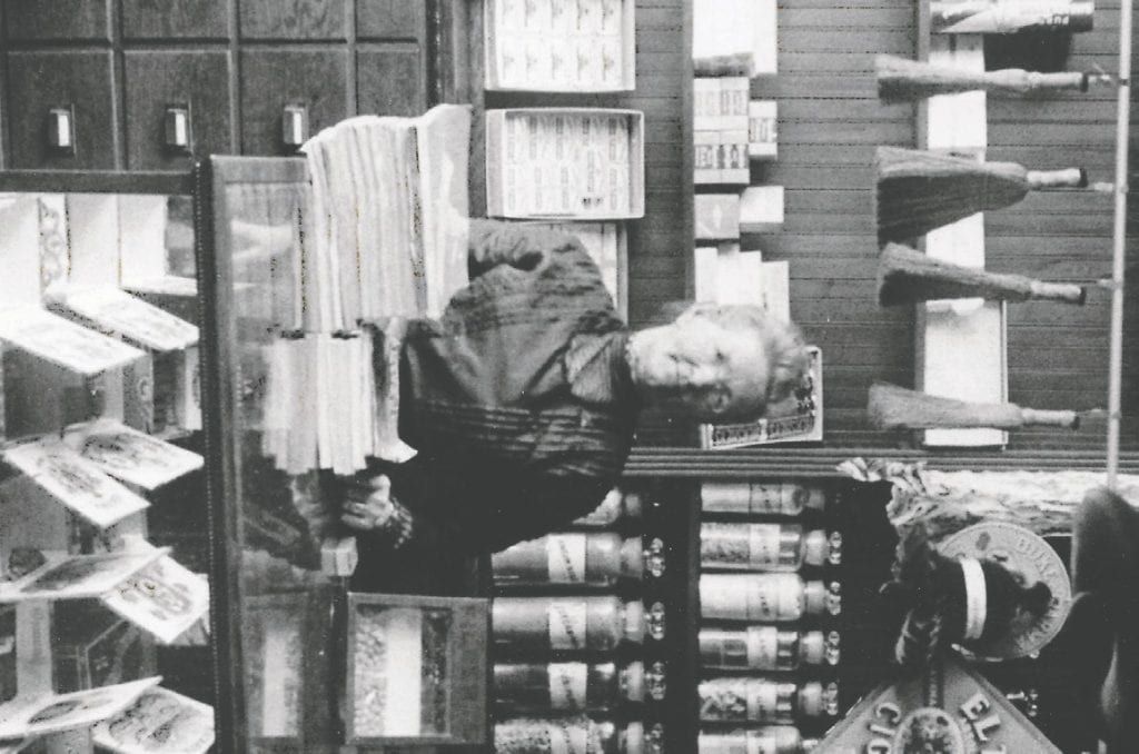 Rachel E. (Thomas) Gran was believed to be one of the first women pharmacists in Minnesota. Here she stands in the drug store she operated in Young America, MN. Submitted photo.