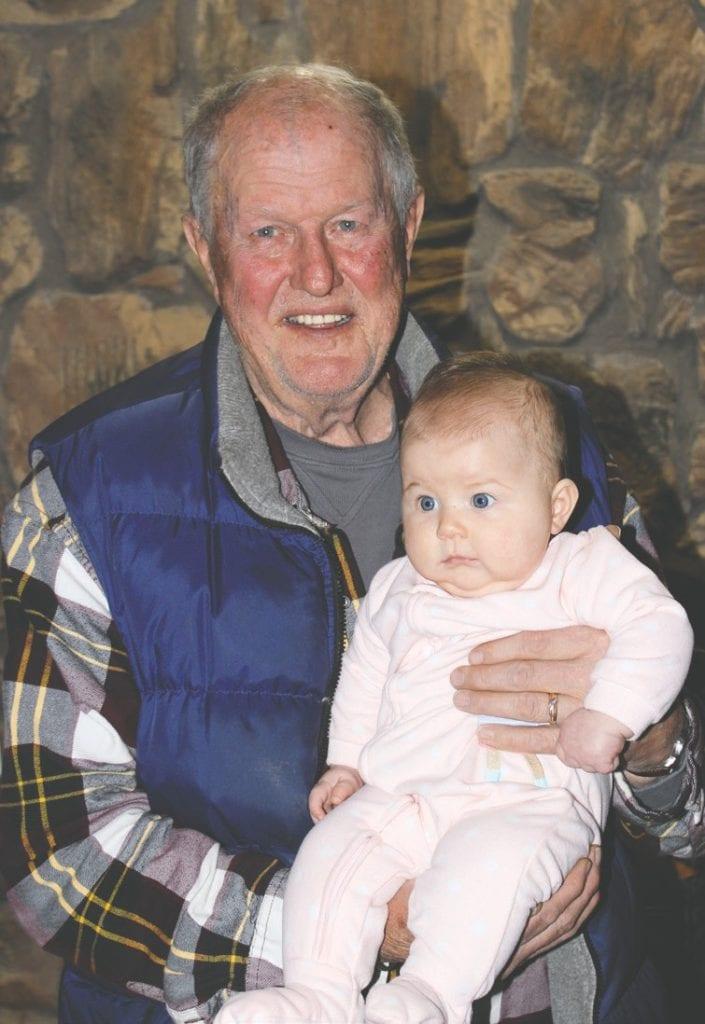 Dewey enjoys holding his granddaughter Joanna Altobelli of Virginia. Photo by Jill Pepelnjak.