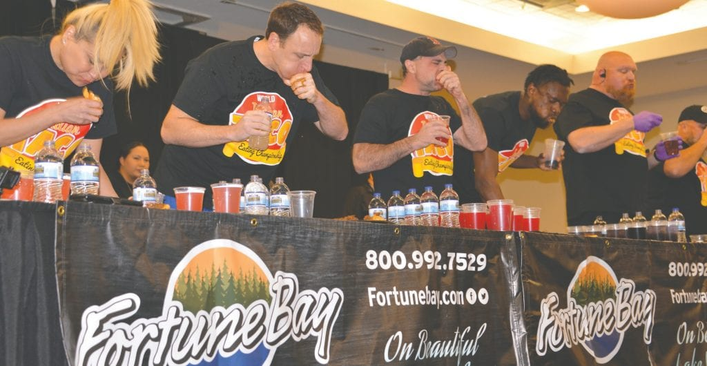 Competitors work to down Indian tacos at the eating contest at Fortune Bay Resort Casino on Saturday, Nov. 3. Submitted photos.