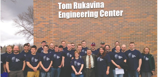 Surrounded by Iron Range Engineering students, former State Representative Tom Rukavina celebrates the unveiling of the newly-named Tom Rukavina Engineering Center at Mesabi Range College in May 2014.