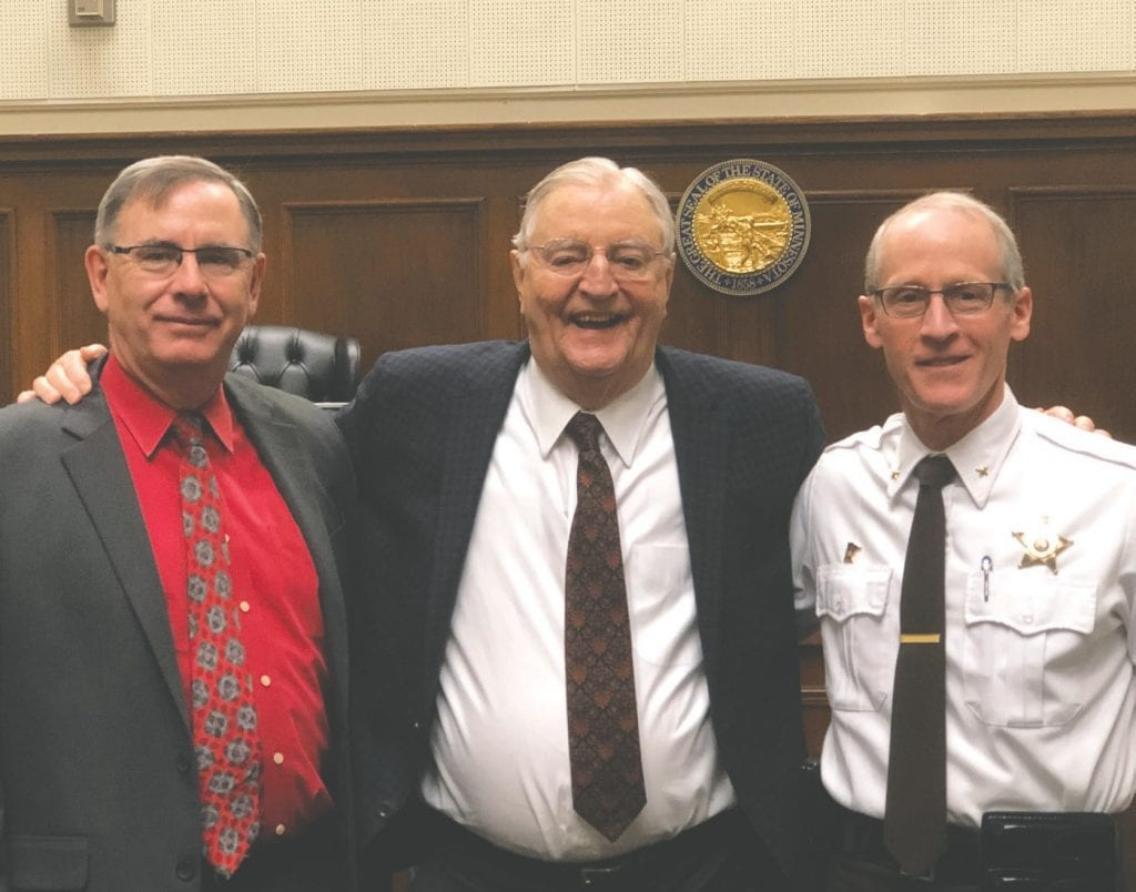 Judge Mark Munger (from left), former Vice President Walter Mondale and St. Louis County Sheriff Ross Litman are pictured on Jan. 7, when Litman was sworn in as St. Louis County Sheriff. Submitted photo.