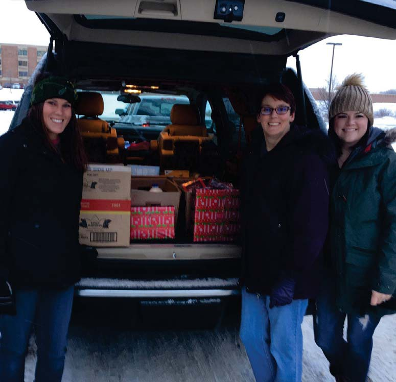 Kaye Collier, Chris Magnusson and Erin Shay packing up the meal kits in December to deliver them to local veterans in need. Submitted photos.