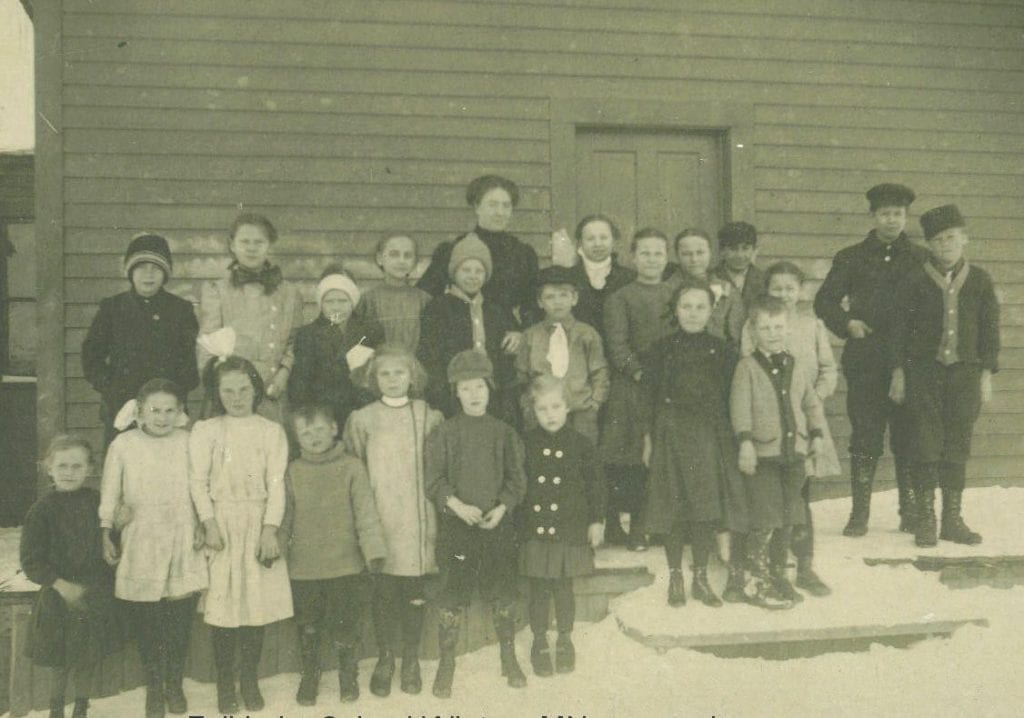 The Fall Lake School (date unknown) is pictured with 22 students and a teacher.