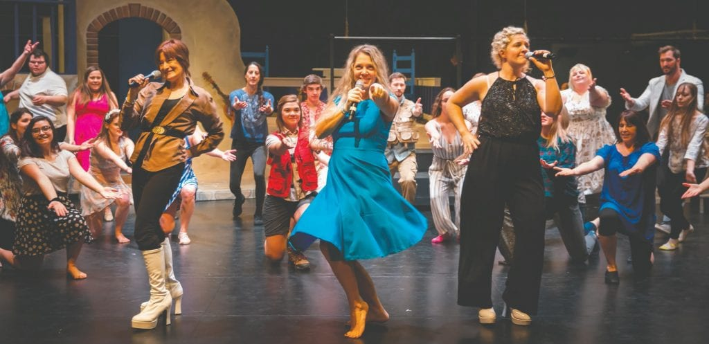 Donna, played by Katie Smith (center), is reunited with her former Dynamos bandmates, Tanya (Marina Whight) and Rosie (Katie Benes), in the Grand Rapids Players' presentation of Mamma Mia at the Myles Reif Performing Arts Center in Grand Rapids. Submitted photos.