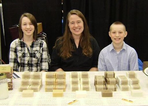 Danyel Filipovich, owner of PLAIN & SIMPLE, offers oldfashioned homemade soaps. Her daughter, Dannie, and son, Jed, help at a local show.