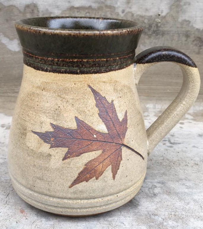 Lisa Wagenbach, owner of Daybreak Pottery, specializes in nature-themed mugs and other useful pottery pieces.