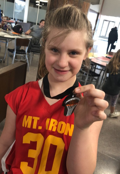 Maddy Unhjem is pictured with her Pacesetter Youth Basketball championship medal. Submitted photo.