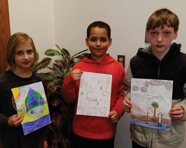 Pictured at right is Water Week Poster Contest winner Kaiden Jackson is flanked by runners-up Josie Fruetel, left, and Connor Wolff.