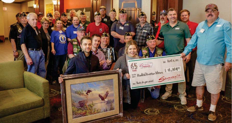 Members of the Sammy's family presented a $16,964 check to the DAV recently during the annual DAV state convention at the Holiday Inn & Suites in downtown Duluth. Submitted photo.