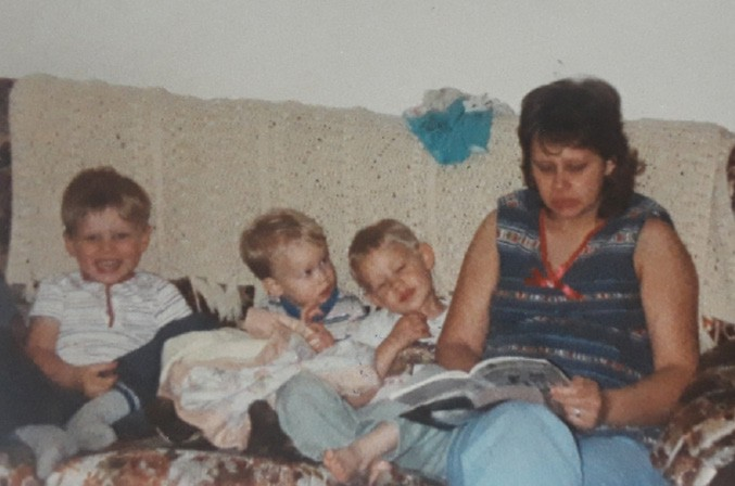 On p. 44, my big head mostly obscures my mom while my grandma appears way in the background of this photo when I was age two or three. Above, my mom reads to (from left) me, and my brothers Jon and Tim at our house in Palo. Photos submitted by author.