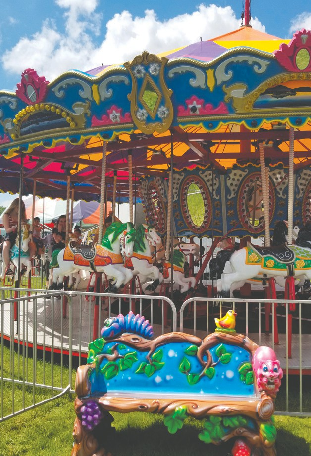 The Merry-Go-Round with colorful horses at Kidway, sponsored by DISH, is one of three new rides found at the fair.