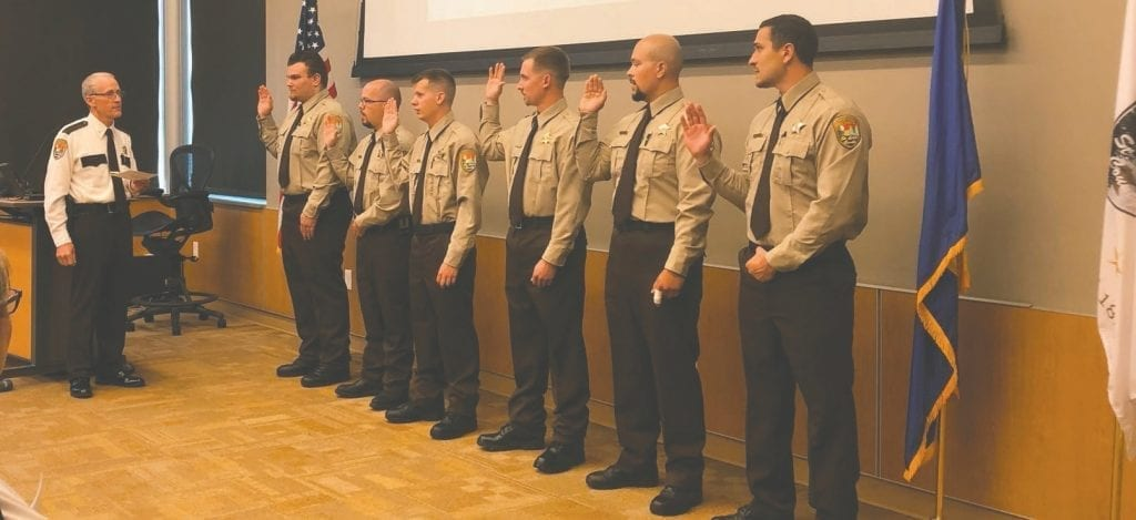 Nine new corrections officers were sworn in, including (l. to r.): Christopher Anglin, Chad Brownlee, Tyler Helget, Kyle Niemi, Jose Plascencia and Dominiick Schmitz. Not pictured are Noah Johnson, Troy Krahl and Cody Kultala.