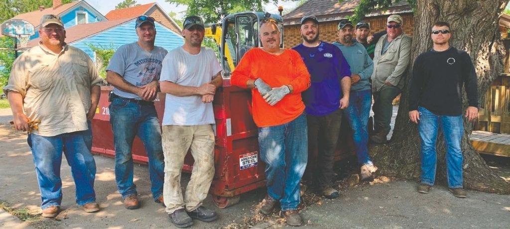 U.S. Steel Serve volunteers—a group of miners and veterans—are pictured at the UWNEMN/MACV transitional home. Volunteers were: Joel Kardell, David Toole, Ryan Weiss, Jarod Vitek, Chad Buus, Jason Croteau, Craig Platt, Robert Devyak and Ryan Ganyo.