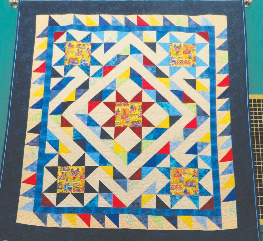 This is a photo of the guilt on display at the Virginia Public Library during the month of November. Created by Betty Soderberg, the quilt is a study in patriotic themes and colors of Veterans Day. This quilt will be awarded to a local female veteran through the Quilts of Valor program. Submitted photos.
