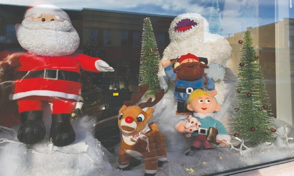 Rudolph the Red-Nosed Reindeer and other characters from the 1964 TV special watch from the window of Up North Dental (215 Chestnut Street). In the show, the character Hermey (with blond hair next to the tree) dreams of becoming a dentist. Photo by Cindy Kujala.