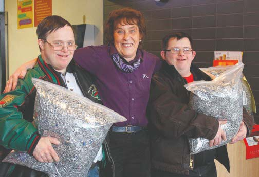 Kevin Rice (left) and Jordan Benz (right), both from Virginia, collected and dropped off three bags of pop tabs at McDonald's in Virginia. Brenda Dennis (center), McDonald's shift manager, accepted the donation of pop tabs, which will go to help raise money for Ronald McDonald houses. Photo by Jill Pepelnjak.