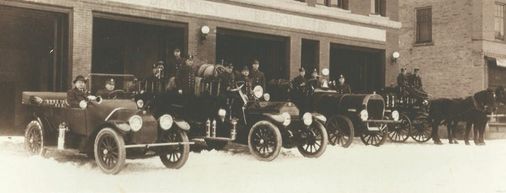 Virginia firemen, vehicles, and horses circa 1920.
