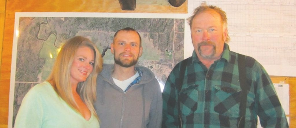Charity, Jason, and Mike Helstrom in the office at their farm. Submitted photos.