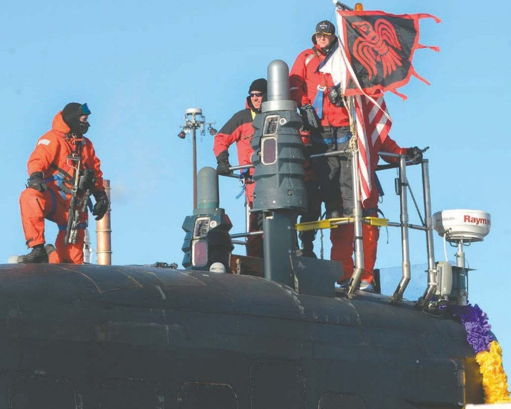 Sailors assigned to the Virginia-class fast-attack submarine USS Minnesota (SSN 783) stand topside as they pull into their homeport at Naval Submarine Base New London in Groton, CT, Dec. 20, 2019, following a deployment. Minnesota deployed to execute the chief of naval operation's maritime strategy in supporting national security interests and maritime security operations. U.S. Navy photo by Mass Communication Specialist 1st Class Steven Hoskins/Released.