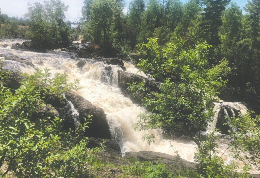 """Kawishiwi Falls near Ely. In describing Kawishiwi Falls, the www.ely.org website says, """"The watershed drains from the Boundary Waters Canoe Area Wilderness (BWCAW) and flows 2,000 miles north to Hudson Bay. Submitted photos."""