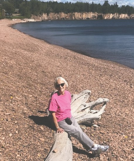 Betty Pond sits on a wood log and poses for a picture while exploring Iona's Beach. Submitted photos.