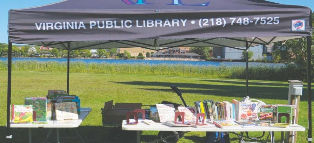 You can find Virginia Public Library staff on Thursdays from 2:30 – 6 p.m. at their booth at Virginia Market Square next to Silver Lake. Submitted photo.