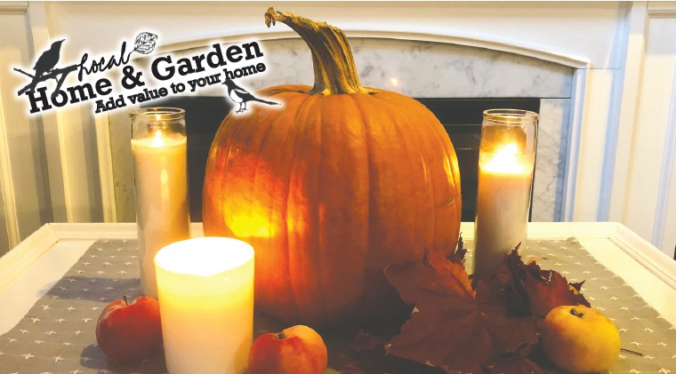 Pumpkins, leaves, and candles are just a few ways to make your house a warm, cozy home this fall. Photo by Carrie Manner.