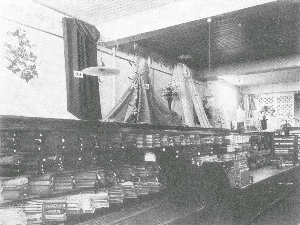 An aisle in Itasca Mercantile Company's store, circa 1909.