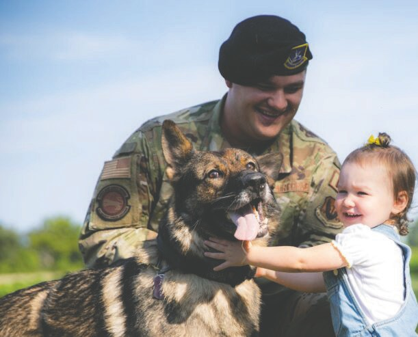 SSgt Johnson and young daughter welcome Chicel to the family.  Photo courtesy American Humane.