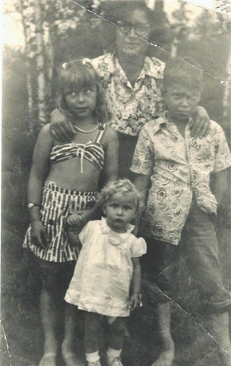 Mary Oksanen with children Betty, Dick and Nancy in 1952. Betty believes her mother's blouse and brother's shirt may have been made from food bags.  Photos submitted.