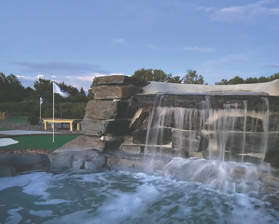 A picturesque waterfall is just one of the many attractions on the mini golf course.  Stones were hand picked for each layer of the waterfall.