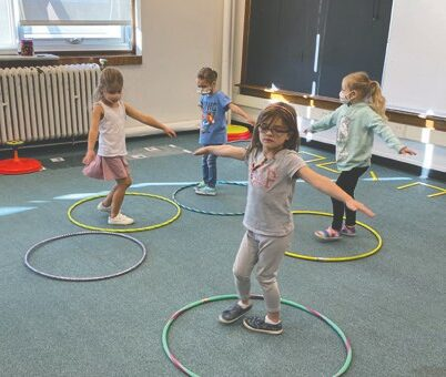 Students practice spinning, and the creep track, and crossover movement with Mrs. Perko during S.M.A.R.T.